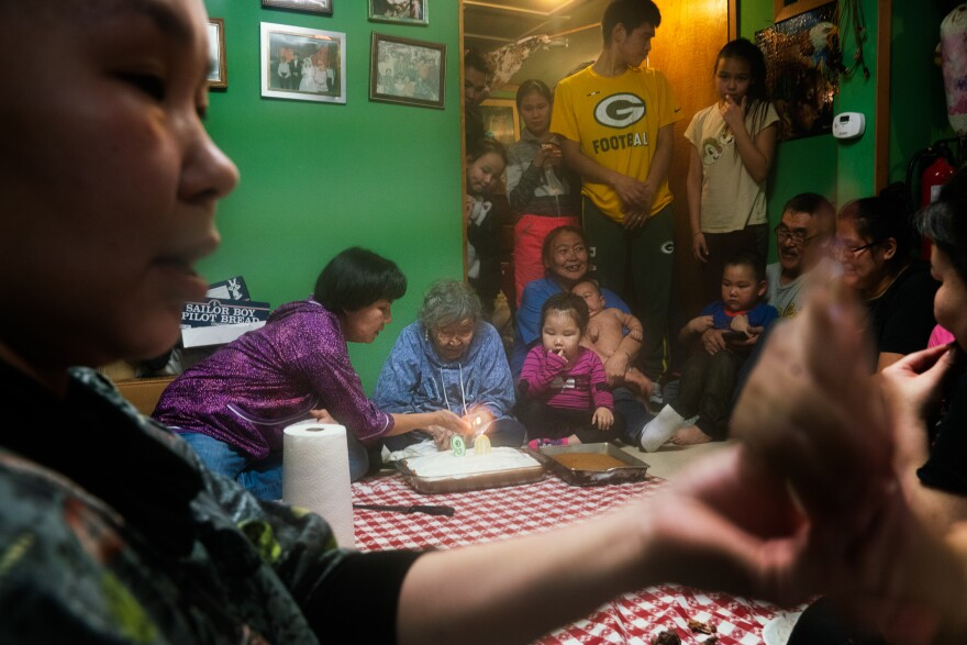 Lizzie Chimiugak Nenguryarr's family gathers to celebrate her 90th birthday at her home in Toksook Bay. She was the first person counted for the 2020 census.