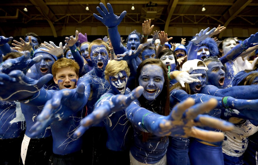 Duke fans cheer prior to the tip-off between Duke and North Carolina in an NCAA college basketball game in Durham, N.C., on March 8, 2014.