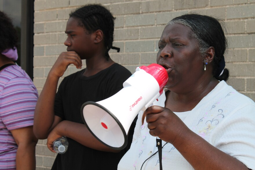 Elinor Simmons, a 30-year home care attendant speaks during a protest outside of Paraquad in St. Louis. (June 2015)
