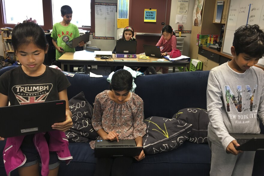"""Students in Scott Bedley's fifth-grade class at Plaza Vista School in Irvine, Calif., play a version of """"Simon Says"""" with fake news."""