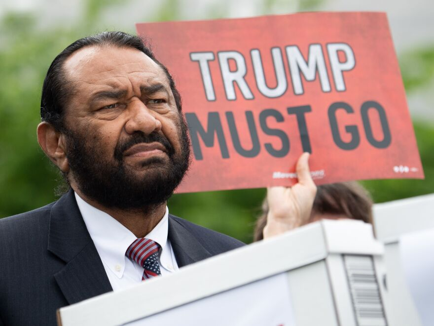 Rep. Al Green speaks during a news conference in May as activists urge Congress to begin impeachment proceedings against President Trump.