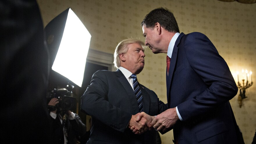 President Trump shakes hands with James Comey, then-director of the FBI, during a reception at the White House on Jan. 22.