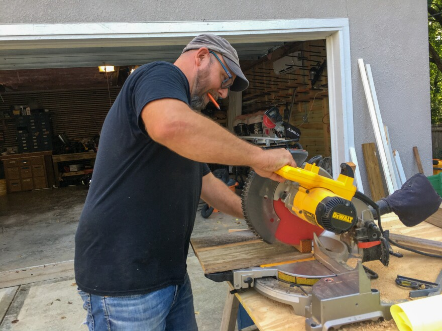John Buhr now devotes much of his time to fixing up his family's home in Kansas City. He's building a playhouse for his young children, an apartment for the grandparents to use on their extended babysitting visits and an office for his wife, who supports the family working in the tech industry.