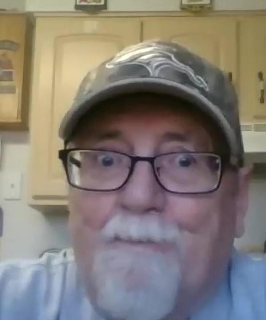 An older man in a Zoom videochat screenshot