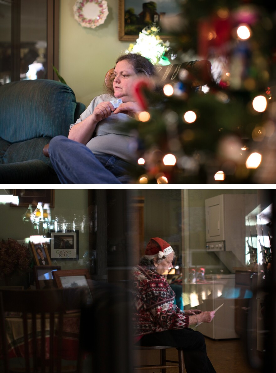 """For me the hard part is that my mother-in-law is still with us physically, but mentally she's not there,"" Mary says. ""It's almost like having somebody that's a stranger at Christmas."" Helen sorts through family photos. She often talks about life on the farm in Virginia where she grew up."