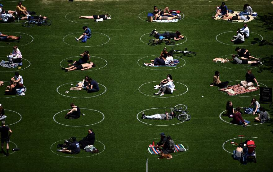 People are seen practicing social distancing in white circles last weekend in Brooklyn's Domino Park.