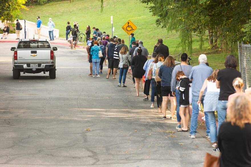 Residents line up to vote at the Austin Recreation Center on the first day of early voting last month.