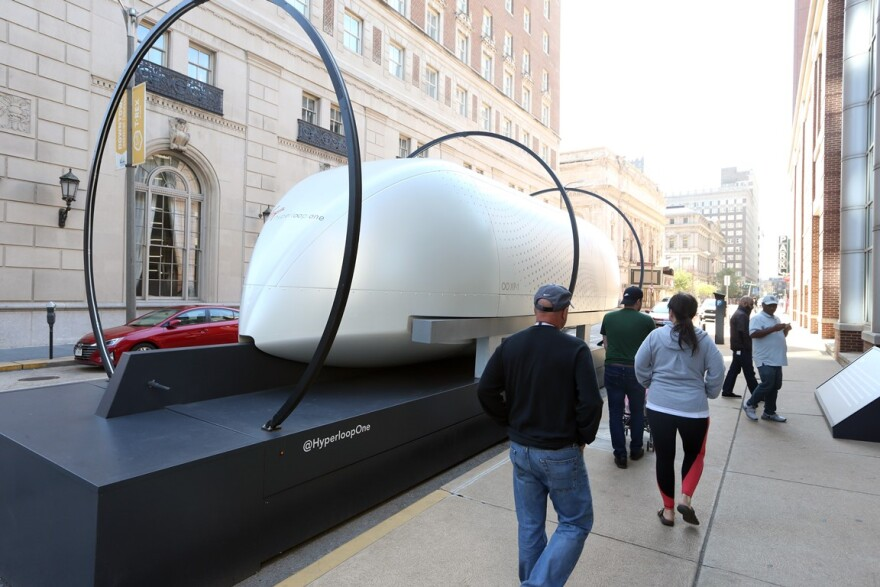 Curious onlookers get a closer look at Hyperloop One as it sits on display on a downtown city street in St. Louis on Tuesday, October 8, 2019.