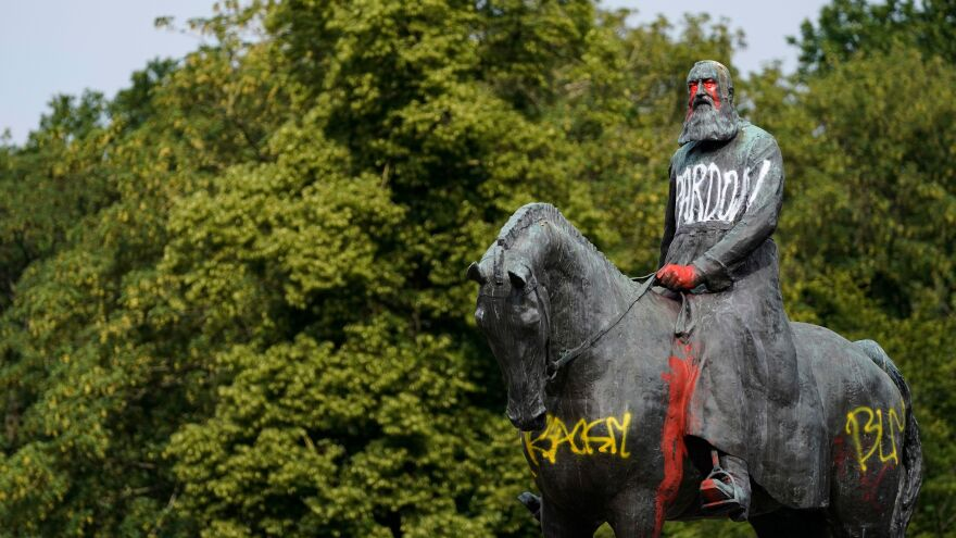"A statue of King Leopold II stands defaced after protests this month in Brussels. Belgian King Philippe acknowledged ""acts of violence and cruelty"" in his country's colonial past in Africa."