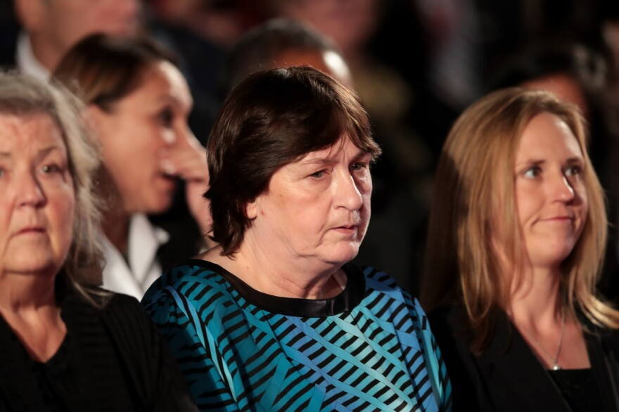 Kathy Shelton (center) sits in the audience at the second presidential debate in October. Shelton was invited to the debate by Donald Trump.
