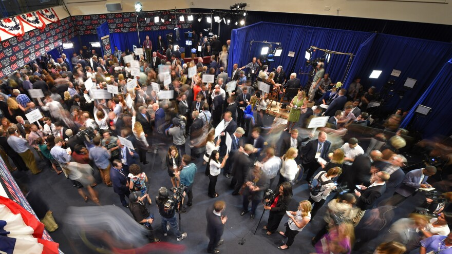 Journalists, candidates and their representatives crowd the spin room after Wednesday night's debate.