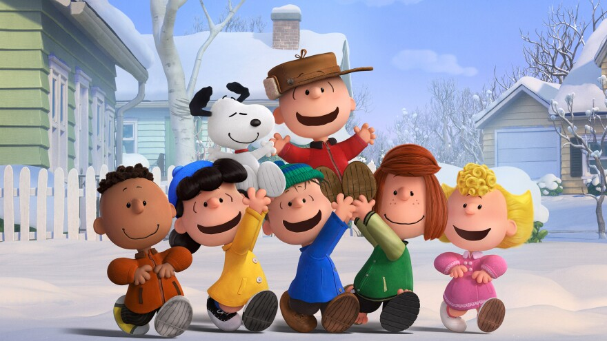Charlie Brown, Snoopy and the Peanuts gang (Franklin, Lucy, Linus, Peppermint Patty and Sally) enjoying a snow day in <em>The Peanuts Movie</em>.