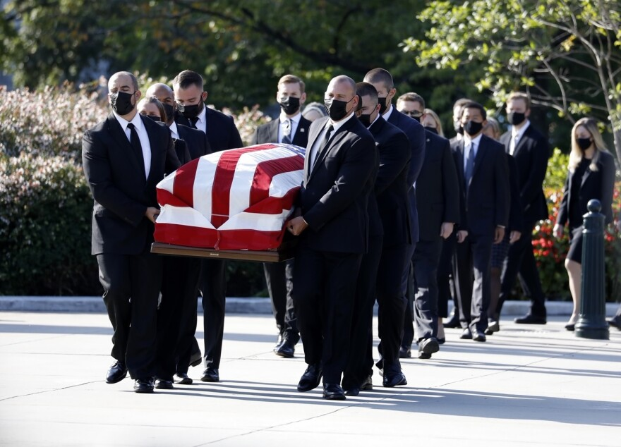 Pallbearers carry the casket of Associate Justice Ruth Bader Ginsburg.