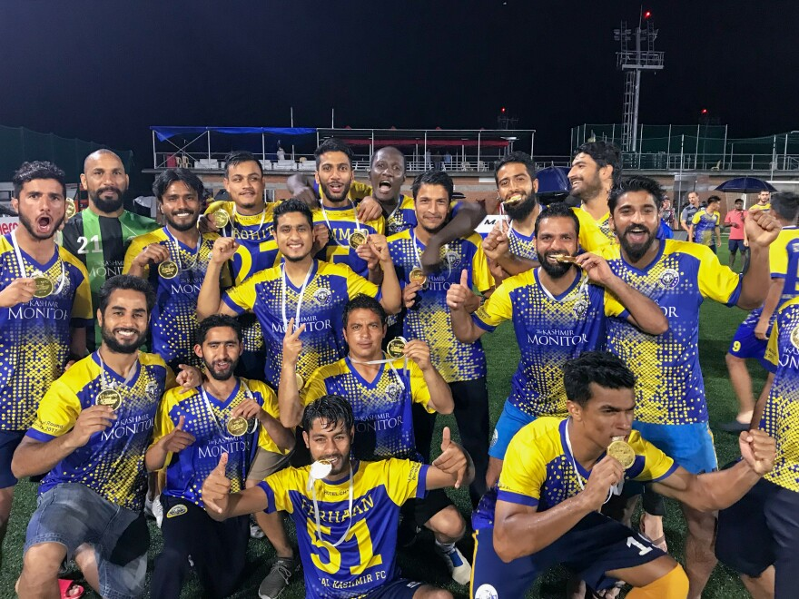 Team photo after Real Kashmir won India's I-League 2nd Division title in May 2018.