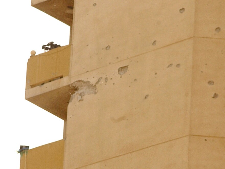 Impacts of a U.S. tank shell are seen on the Palestine hotel in Baghdad in 2003. The Palestine hotel took fire after U.S. troops said snipers were shooting at them from the building. At least five journalists were injured.