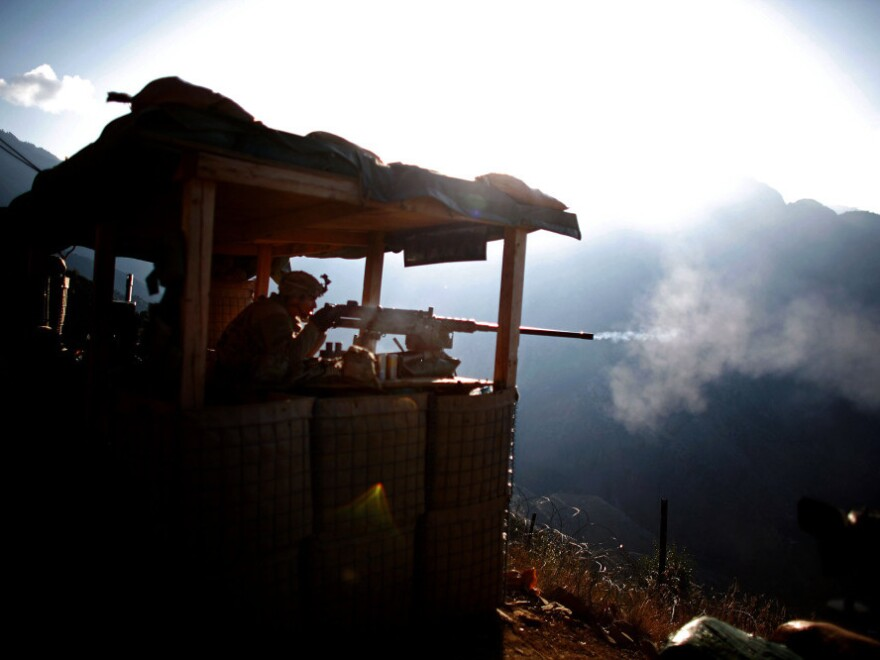 Pfc. Natan Martinez fires a machine gun from a position near the Pakistan border in Afghanistan. There is concern in Pakistan about the U.S. preserving a security presence in Afghanistan beyond 2014, the deadline to pull out most if not all U.S. combat troops.