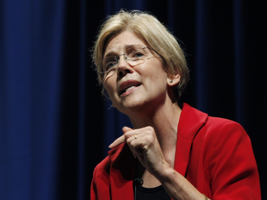 """Elizabeth Warren speaks in October during a debate for the U.S. Senate seat in Massachusetts held by Republican Scott Brown. The race has become a contest of who is the """"real"""" populist."""