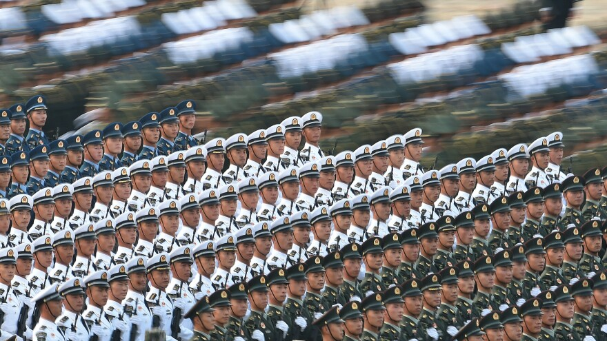 Troops prepare for the military parade marking the 70th anniversary of the founding of the People's Republic of China on Tuesday in Beijing.