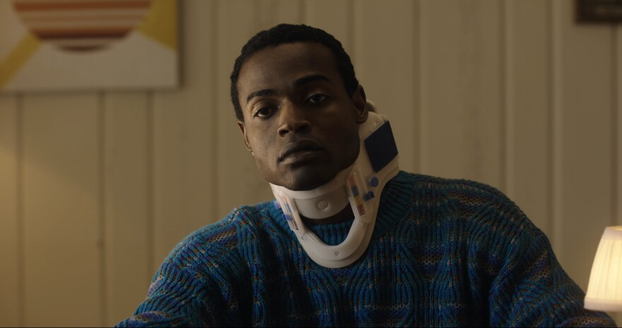 Lance (Lance Jeffries) turns to self-help tapes to heal after heartbreak in Chloé Aktas' <em>Lance (in a Neck Brace).</em>
