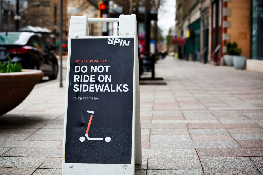 Photo of a sign that reads: Do not ride scooters on sidewalks.