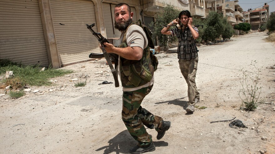 Syrian rebels take part in a battle Thursday in the northwestern town of Maaret al-Numan. The U.S. says it will begin providing arms to the rebels, who have been losing ground recently to the Syrian army.
