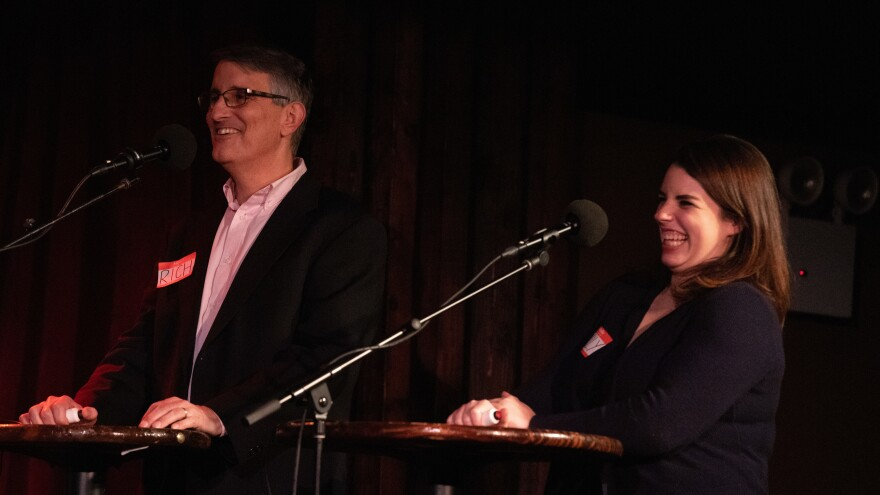 Contestants Rich Fisler and Emily Mongeau play trivia games on <em>Ask Me Another</em> at the Bell House in Brooklyn, New York.