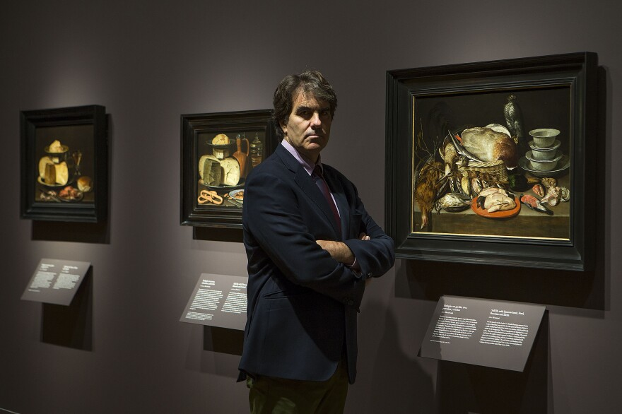 Alejandro Vergara, curator of northern European paintings at the Prado Museum in Madrid, stands in front of several works by 17th century Flemish artist Clara Peeters. She is the first woman to receive her own exhibition at the nearly 200-year-old museum.