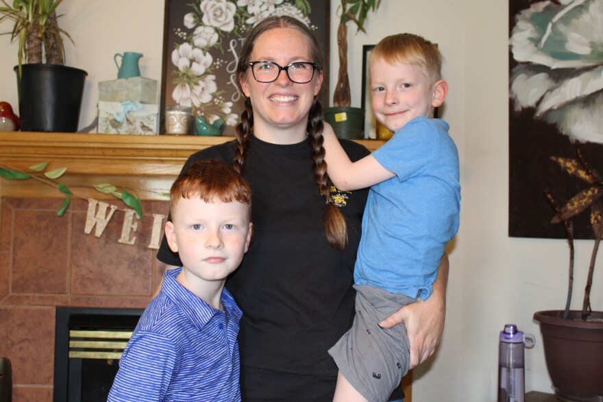 Lindsay Drees's son Armstrong, right, started kindergarten a year late this fall. Another son, Abraham, left, is a third-grader. (Photo by Suzanne Perez)