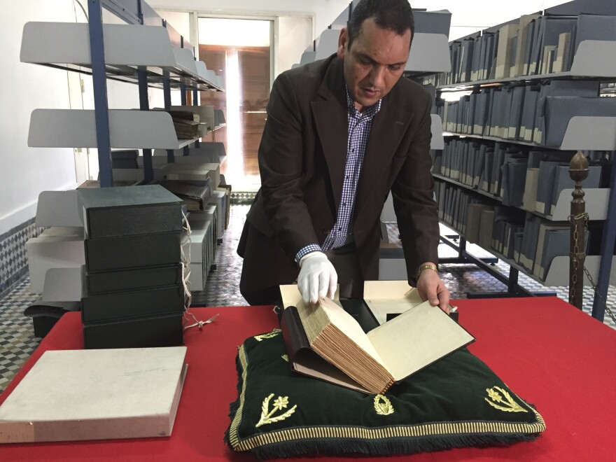 The curator of the Qarawiyyin Library, Abdelfattah Bougchouf, opens an original version of a famous work, <em>Muqaddimah</em>, written by historian Ibn Khaldun in the 14th century. The library in Fez is one of the world's oldest working libraries, dating to the 10th century when it was founded by a pioneering woman. The library is set to reopen in May following a renovation.