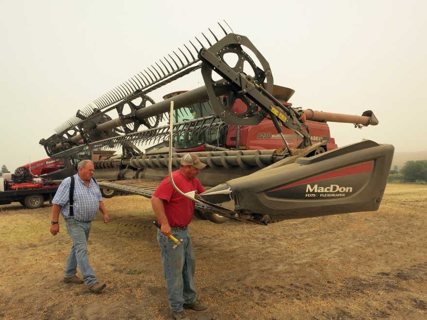 Chad (right) and Lee Heimgartner harvest chickpeas near Kendrick, Idaho. Until this past spring, farmers along the Washington-Idaho border shipped beans and peas in containers to the Port of Portland.