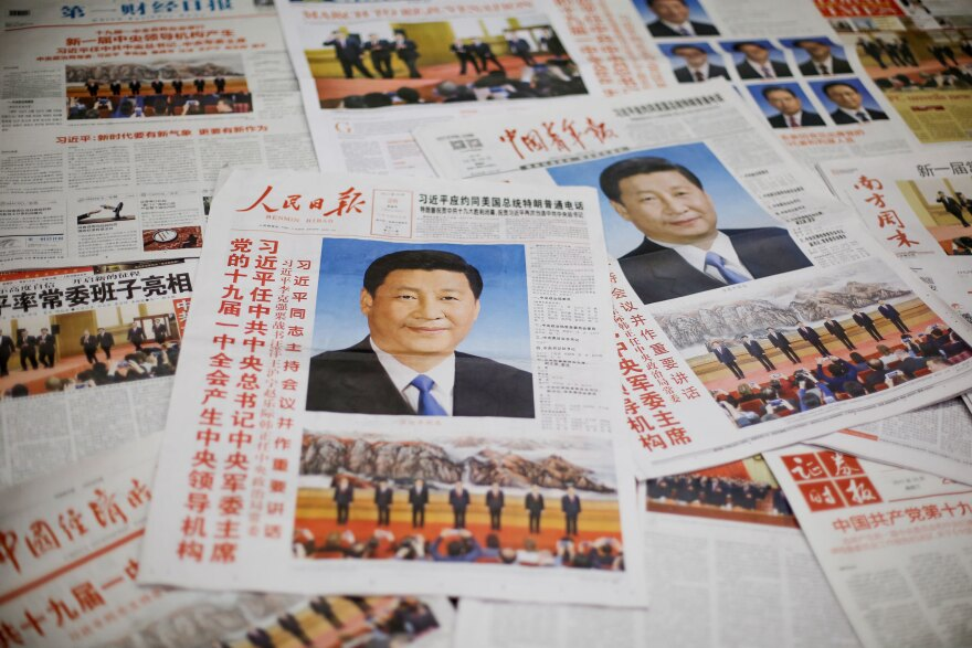 The front page of the Communist Party's flagship newspaper the <em>People's Daily</em> (center) and other papers are seen one day after the unveiling of the new Politburo Standing Committee in Beijing last year.