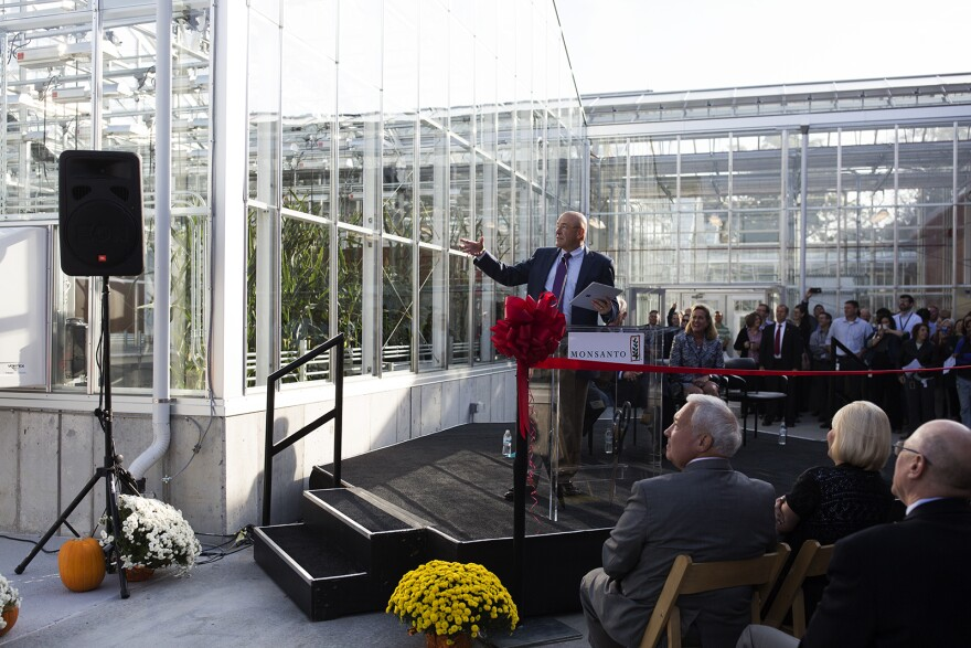 Robb Farley, chief technology officer for Monsanto, switches on the lights in the company's new greenhouses on Oct. 28, 2016.
