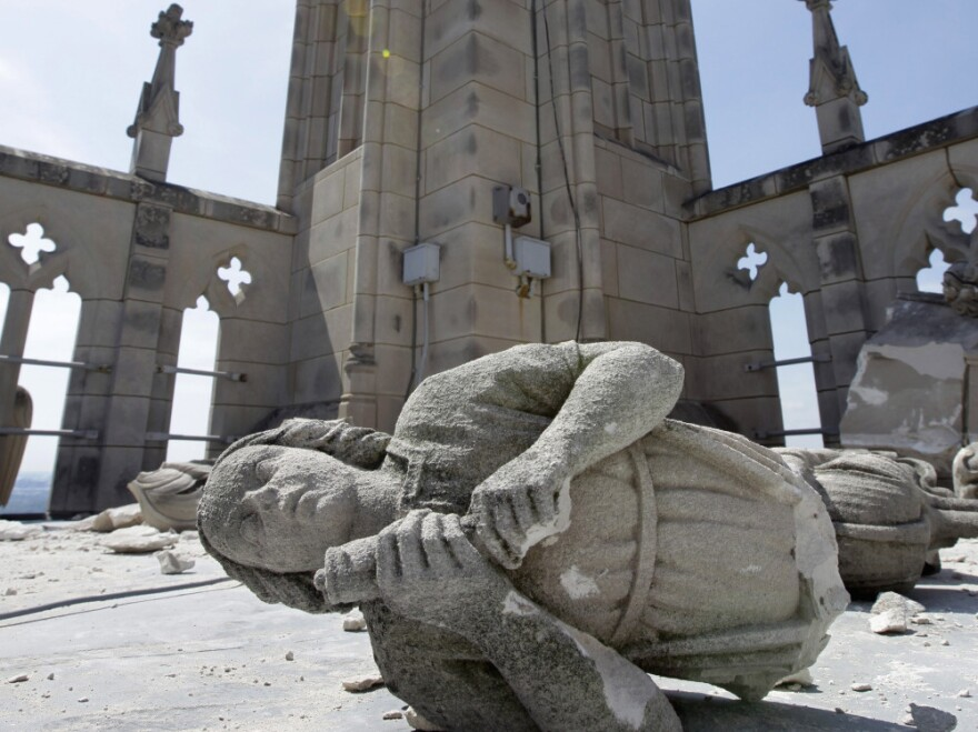 """An angel, carved from Indiana limestone, lies shattered amid other damage on the roof of the Washington National Cathedral after an  earthquake struck on August 23. The cost of repairs could run """"well into the millions,"""" a church official said."""