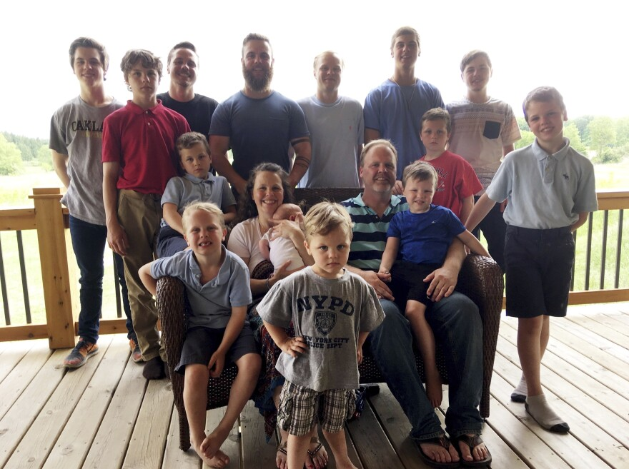 The Schwandt family poses for a photo in 2018 at their farm in Lakeview, Mich. Standing from left are Tommy, Calvin, Drew, Tyler, Zach, Brandon, Gabe, Vinny and Wesley. Seated, starting at upper left are Charlie, Luke, mother Kateri holding Finley, father Jay with Tucker and Francisco in the foreground.