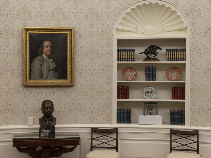 A moon rock is displayed on a bookshelf in the Oval Office.