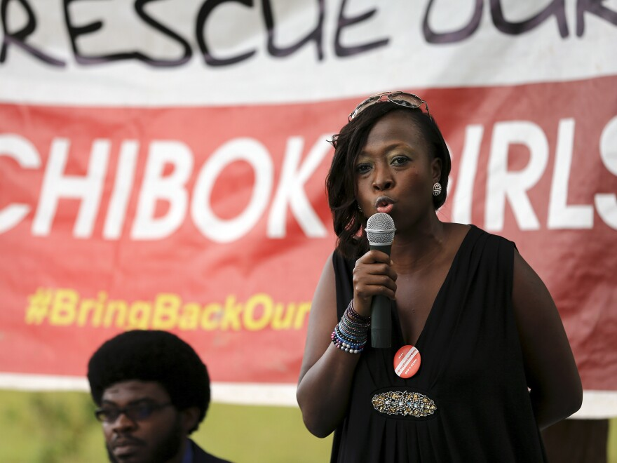 "Maureen B. Kabrik, a ""#Bring Back Our Girls"" campaigner, speaks during a sit-out meeting in Borno in support of the release of more than 200 Nigerian schoolgirls in August. Boko Haram militants, who seized the girls last April, have reportedly captured a key military base in the region."