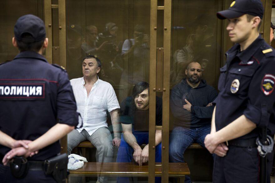 Lom-Ali Gaitukayev, Ibragim Makhmudov and Sergey Hadjikurbanov, accused of the murder of journalist Anna Politkovskaya, await the judge's verdict in a glass cage at the Moscow City Court in Russia.