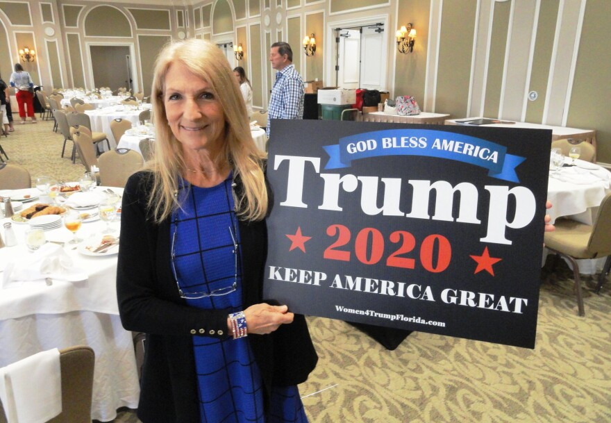 Vickie Rubin holds up sign for President Trump