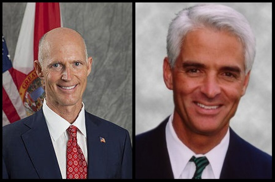 Gov. Rick Scott (left) and Democratic candidate Charlie Crist (right) appeared with Democratic hopeful Nan Rich on Wednesday.