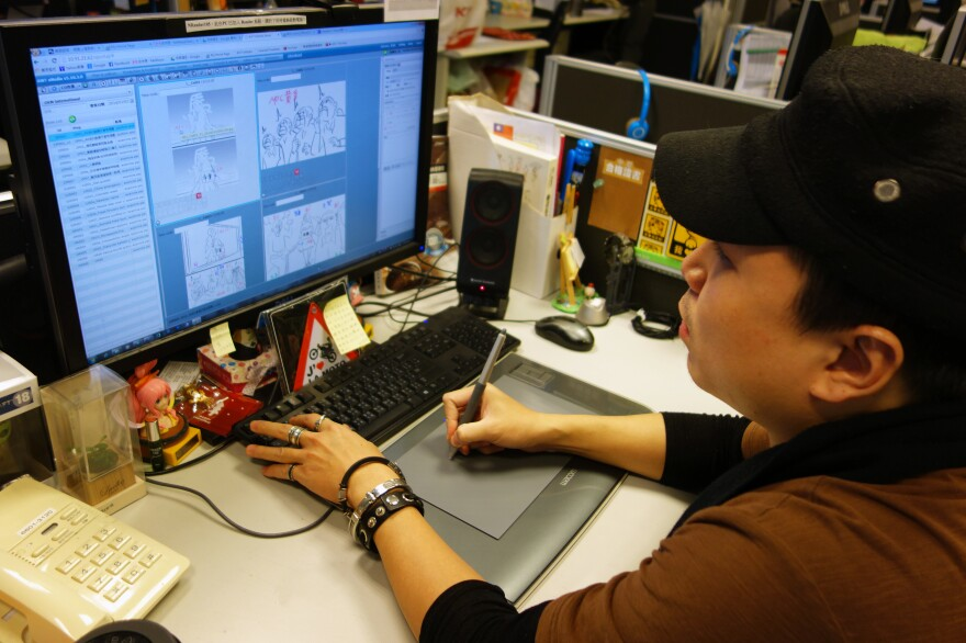 An animator at Next Media goes to work, drawing out the movements of characters in an upcoming story.