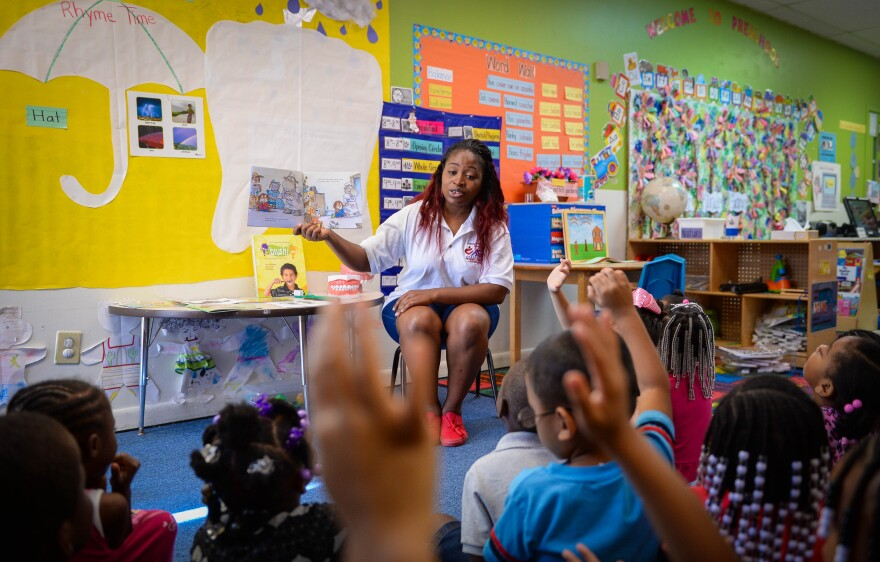 """Willona Milton reads from """"Just Going to the Dentist"""" to her class at Morton Clark Head Start in Bradenton"""