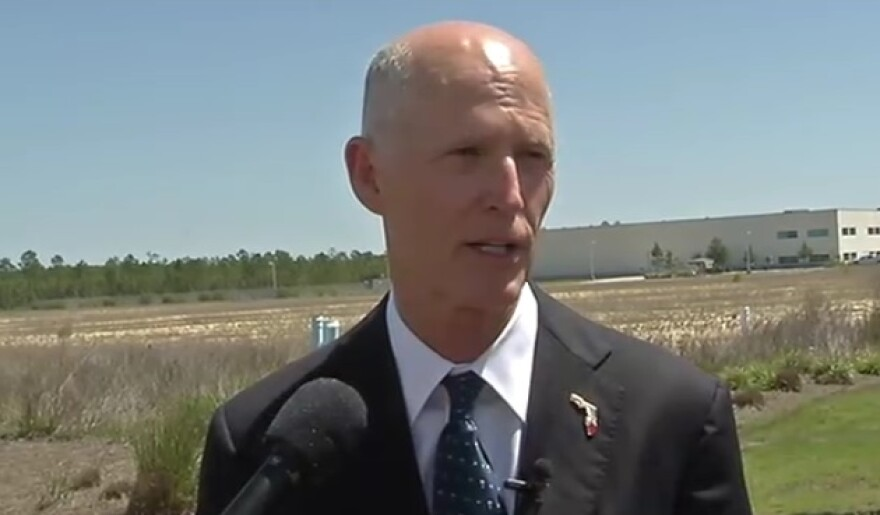 Governor Rick Scott speaking to reporters in Panama City Tuesday.