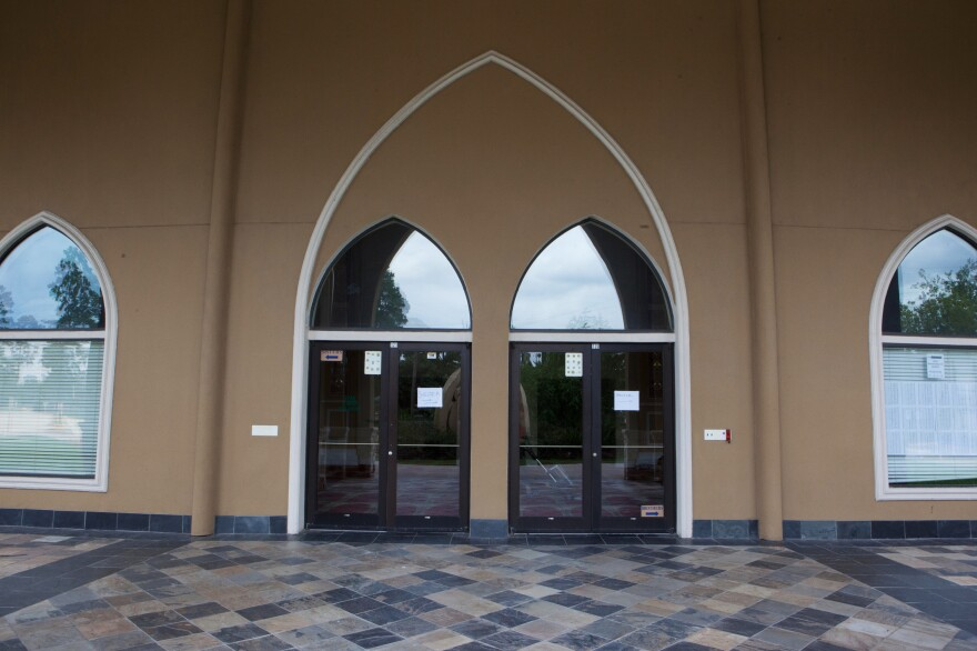 Al-Salam mosque in Houston opened its doors and offered shelter during Hurricane Harvey. The doors have paper signs taped to them directing people to the shelter area.