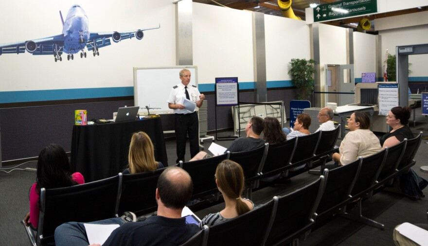 "Ron Nielsen, a retired airline pilot, tells his class of fearful fliers in Southern California that crying can be a useful emotional release. If that's what they need to do, he tells them, ""let 'er rip!"""