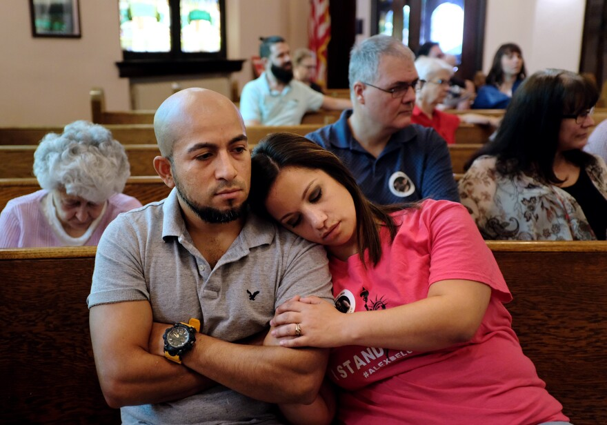 """Alex and Carly Garcia listen to a Sunday sermon which kicked off a """"week of action"""" in support of their family."""