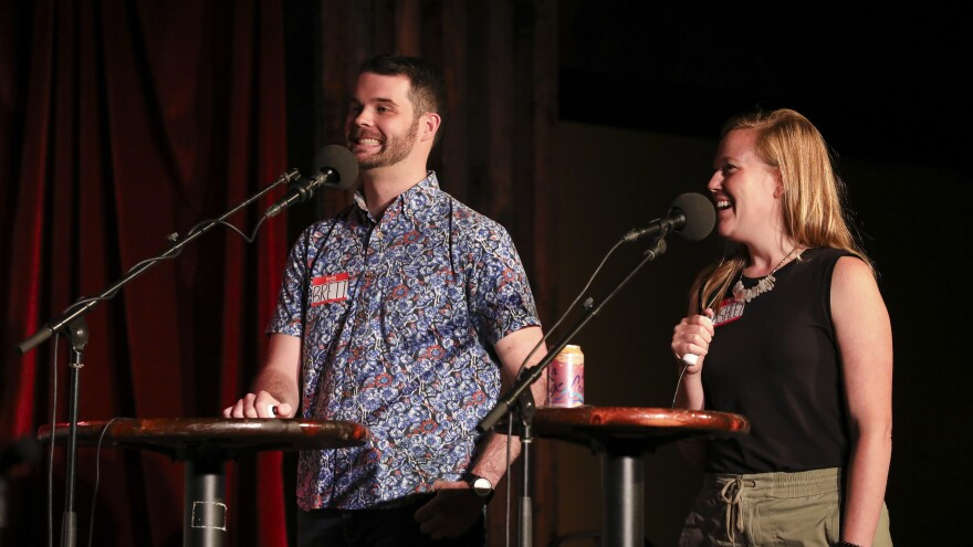 Contestants Brett Greenfield and Ashley Davis appear on <em>Ask Me Another</em> at the Bell House in Brooklyn, New York.
