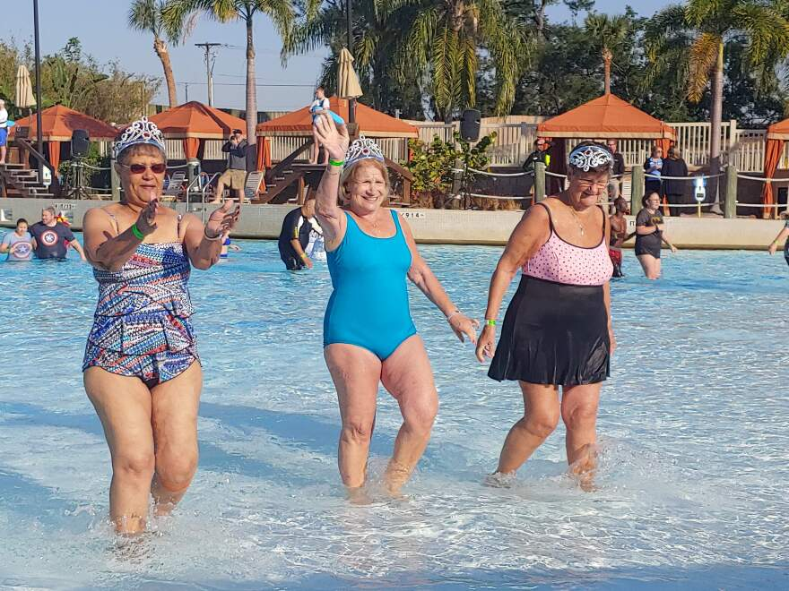 Billie Smolenaars (right) walks back to grab a towel with her friends after participating in the Polar Plunge on Saturday, March 23.