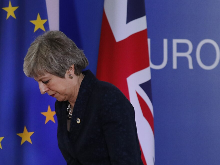British Prime Minister Theresa May leaves after addressing a media conference at an EU summit in Brussels on Friday.