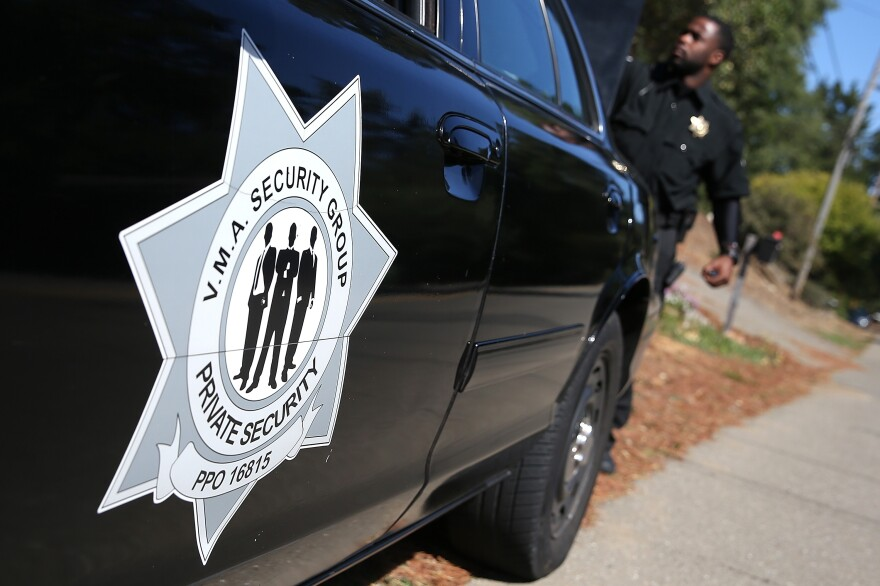 Security officer Steven Long patrols the Sequoyah Hills neighborhood in Oakland, Calif. With city police struggling to control crime, several neighborhoods have hired private security to patrol local streets.