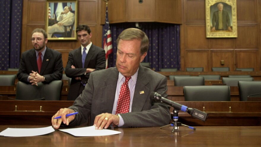U.S. Rep. Michael Oxley, R-Ohio, signs subpoenas for WorldCom executives  in June 2002, ordering them to appear before the House Financial Services Committee. Oxley died Friday at the age of 71.